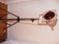 500 watt spotlamp mounted on chromed steel tripod.