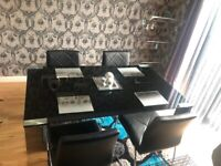 Harvey's Black glass Table and chairs for sale