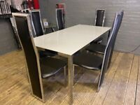 WHITE GLASS DINING TABLE + 6 LEATHER CHAIRS WITH SILVER FRAME USED IN NICE CONDITION