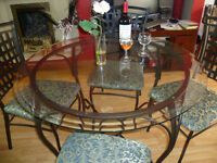 Round glass Dining Table with 4 Metal upholstered chairs