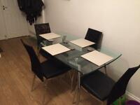 Glass dining table with chrome legs w/ 4 matching chairs
