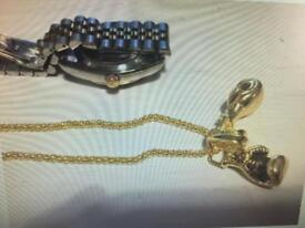 Gold tone chain necklace with double boxing gloves