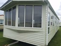 JUST INTO STOCK AT SANDY BAY IS THIS DG & CH 3 BED STATIC CARAVAN WITH DIRECT BEACH ACCESS LOW FEES