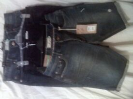 next shorts all brand new still got tags on ' 2 pair in blue jean size 34. 1 pair black 32