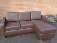 Very nice Brand New brown leather corner sofa,or 3 seater and footstool. can deliver