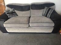 Grey sofa and swivel chair