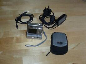 Fujifilm Finepix F450 mini digital camera with docking station, camera case, and much more.