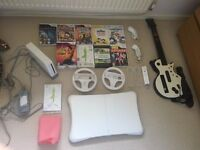NINTENDO WII WITH GAMES, REMOTES AND FITNESS BOARD