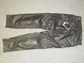 Leather biker trousers with padding.