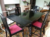 1930/40 Extending dining table with barley twist legs and 4 comfortable chairs