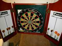 Dart Board - good as new with 8 darts