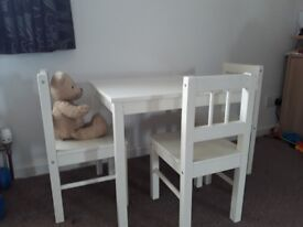 Childrens white table and 3 chairs.