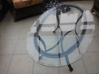 Glass top table with bronze metallic looking legs,great condition.