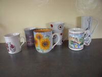 6 asst mugs - cat; goose; leopards; Ashdale sunflowers; Kiln Craft tulips; tall Johnson Bros spots.