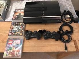PS3 console with Two controllers and 3 games