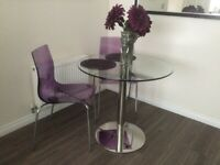 Contemporary Enzo glass table & two chairs. £125.
