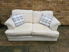 Perfect condition cream coloured 2 seater sofa