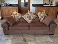 Brown three seater sofa with two matching arm chairs