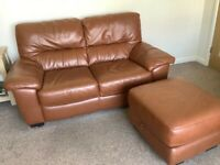 Two x Two leather seater sofas and storage footstool