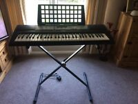 Yamaha electronic keyboard with stand
