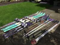 3 pairs of vintage skis and poles