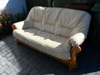 3 seater cream leather sled style sofa with removable cushion