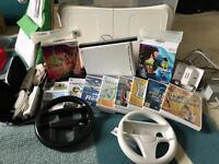Wii & wii fit board plus controllers, games etc