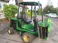 JOHN DEERE RIDE ON TRIPLE CYLINDER MOWER FOR LARGE GRASSED AREAS.