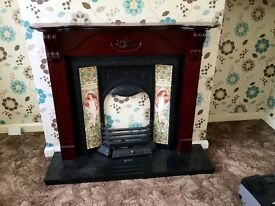 Mahogany fire surround with cast centre and black hearth.