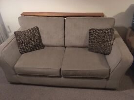 Two seater sofa and footstool/poof in excellent condition