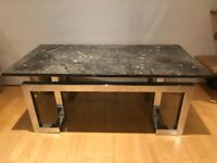 Beautiful limestone coffee table with metal base and embedded fossils