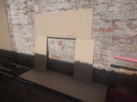 Stone fire surround and hearth