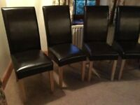 4 stylish faux leather dining chairs in excellent condition