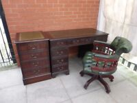 A Green Leather Inlay Twin Pedestal Desk, Filing Cabinet and Captains Chair