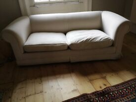 Well made cream sofa bed feather pillows