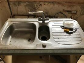 Sink including taps
