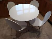 Kitchen dining set. Four chairs. Gloss White. dining table and chairs. Mark's and Spencer