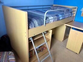 Cabin bed includes mattress with desk & chair