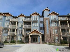 $312,900 - Condominium for sale in Cochrane