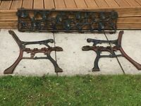 Decorative, cast iron side pieces and back rest for a garden seat.