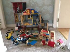 Wooden Police and Fire Station with lots of accessories.