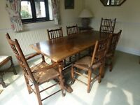 Oak refectory dining table and 6 chairs including 2 carvers