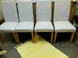 NEXT, SET OF FOUR HIGH BACKED PADDED DINING CHAIRS, WITH SOLID OAK LEGS