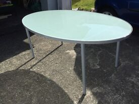 Ikea, classic design oval glass dining table.