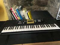 Yamaha YPT-220 electric keyboard with stand
