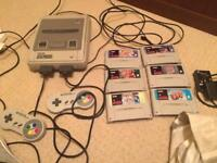 Super Nintendo with 6 games and all cables 2x controllers