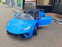 KIDS RIDE ON CAR LAMBORGHINI HURACAN BLUE BRAND NEW WITH RECEIPT