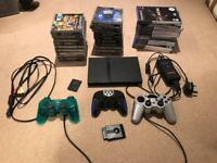 PS2 with three controllers and games