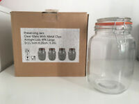 Four large preserving jars