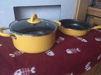 Yellow stockpot and deep frying pan